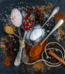 5 teaspoons with various spices, such as salt, pepper and cinnamon